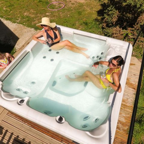 patio-doors-lead-to-additional-decking-with-outdoor-hot-tub