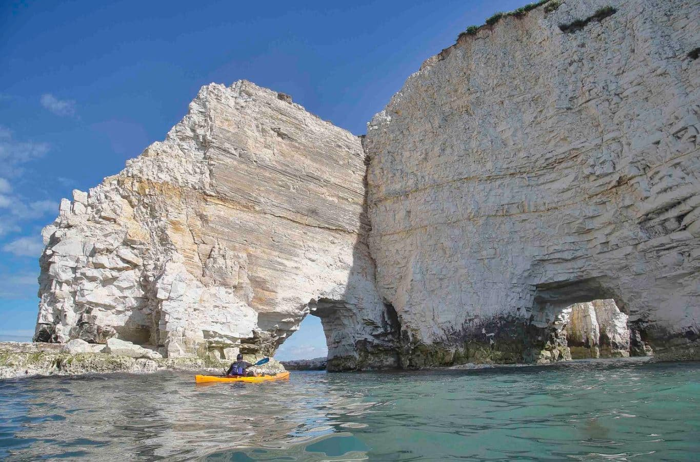 Hire a kayak from Studland Watersports at Knoll Beach to get up close to Dorset's famous Old Harry rocks.