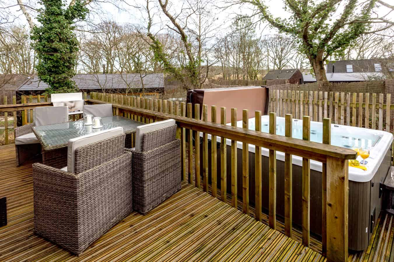 Enjoy birdsong as you unwind over an alfresco lunch or BBQ supper on your fully furnished decked terrace complete with your own private bubbling hot tub